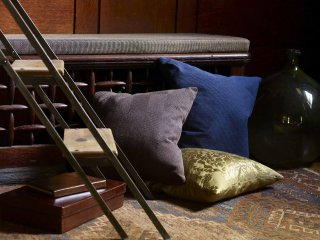 modern gray, blue, and gold pillows by Knoll